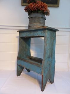 Small bucket bench in original blue paint.