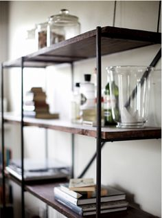 Nice clean lines on these shelves. The open space is great too. I like how they have a space for their bar.