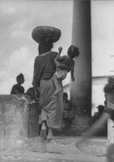 Tina Modotti, (American-Italy) 1896-1942 Isthmus of Tehuantepec Woman with Child at Market Carrying Basket, ca. 1929