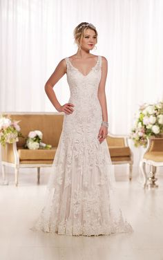 Get this lace A Line wedding dress with clear crystal beading, scalloped shoulder straps, plunging back and V-neckline with a skirt falling into to a chapel train.
