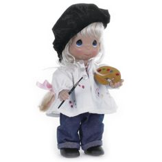 This blonde Precious Moments doll holds a paint brush and palatte with colors which found their way onto her blouse! Description from flossiesgifts.com. I searched for this on bing.com/images