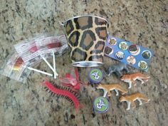 Lion King themed birthday party. Party favor ideas. Pinata fillers. Mini animal print pail. Bugs. Mini animals. Stickers. Self-ink stamps. Yummy Earth lollipops.