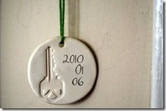 house key ornament-- write the address and attach a photo of the home, so cute