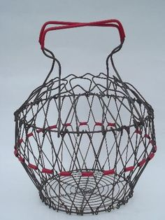 """Vintage wire egg basket with folding collapsible design, measures about 7 1/2"""" deep at it's tallest"""