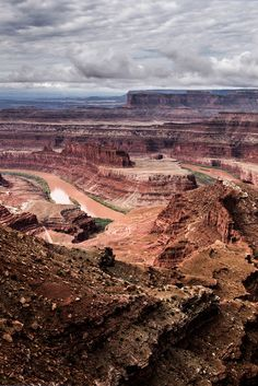 Dead Horse Point State Park is one of the most photographed scenic vistas in the world! This guide tells you the best scenic overlooks in Dead Horse Point State Park, photography tips for your trip, and the legend behind the name of the park. Don't forget to save this post to your travel board.