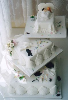 3 tier bedroom theme wedding cake with married couple in bed