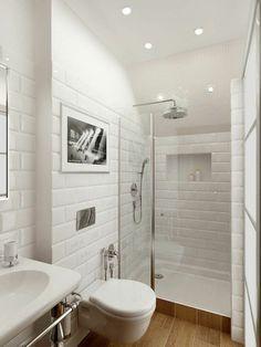 De jolis carreaux blancs et un aménagement pratique d'une petite salle de bain…