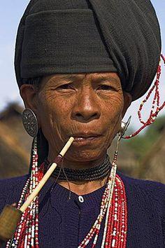 Wan Sai village (Aku tribe), Aku lady smoking wooden pipe, Kengtung (Kyaing Tong), Shan State, Myanmar (Burma), Asia