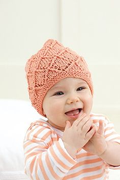 Peach, textured baby hat made with the Knook™. Buy this in a book bundle: http://www.leisurearts.com/sale/bundles/knook-baby-value-pa…