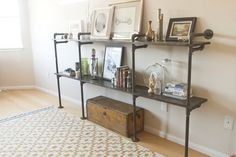 Pipe shelving - a must for the basement organization project!