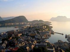 Perched at the top of Norway's Western Fjord country, picture-perfect Alesund is spread over several islands stretching into the Atlantic, with the spectacular Sunnmøre Mountains as a backdrop. If its natural beauty doesn't grab you, its architecture surely will