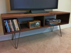 Mid century modern TV table/entertainment console, black walnut with hairpin legs. by scottcassin on Etsy https://www.etsy.com/listing/150974466/mid-century-modern-tv-tableentertainment
