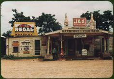 """A crossroads store, bar, """"juke joint,""""  gas station   Melrose, Louisiana, June 1940. Reproduction from color slide by Marion Wolcott. Library of Congress."""