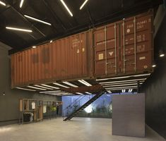 BBC Arquitectos puts shipping containers in Le Utthe store Container Home Designs, Container Shop, Container House Plans, Container Architecture, Container Buildings, Interior Architecture, Shipping Container Conversions, Shipping Container Office, Shipping Containers