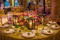 Tablescape of candles and colorful florals