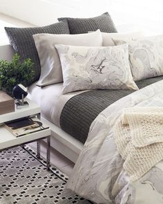 """The possibilities are endless with this fabulously textured cotton voile quilt featuring rows of delicate smocking. Use this deep grey quilt to give neutral bedding a modern edge, or contrast it with white sheets and decorative pillows for a modern masculine feel. • 100% cotton voile; 100% cotton batting. • ¾"""" vertical, machine-stitched rows of smocking."""