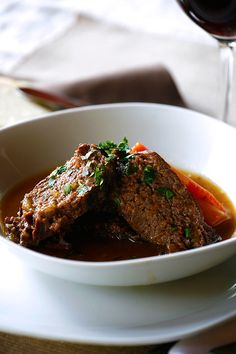 Braised Beef in Barolo Wine Sauce - A hearty Italian entree recipe for braised beef in a Barolo, or red wine, sauce—a perfect Sunday roast.