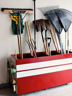 Repurposed file cabinet into the perfect storage bin for large yard tools.  Just lay it on its side and add some pegboard to the sides.