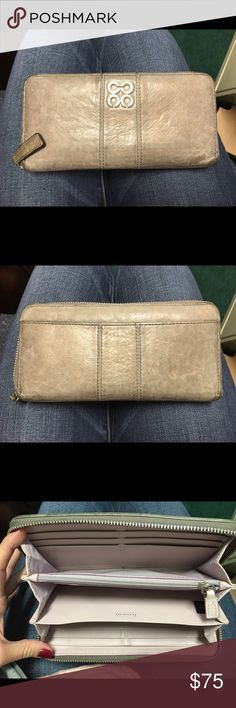 Coach wallet Grey tone coach zip wallet. Normal wear. Good condition Coach Bags Wallets