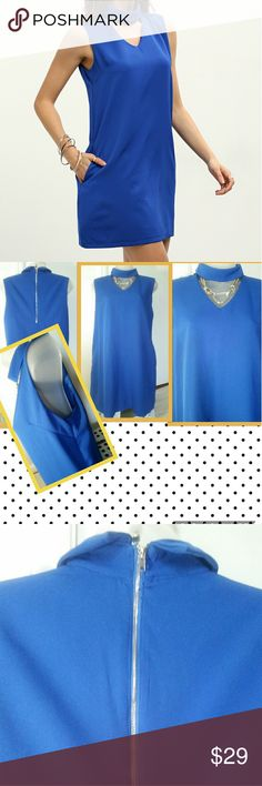 NWOT blue dress NWOT. Didn't wear this.. no place to go. (Got this as a gifts) beautiful blue dress..silver zipper in back.. size large but fit meduim. Silk inside .Pocket front both side Exactly in the stack photos. --- Dresses Mini