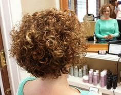 Curly graduated angled bob...by Kenya Elle