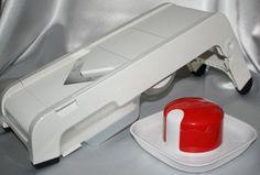 Tupperware Time Savers Mandoline Slice Cut Tupperware http://www.amazon.com/dp/B00IQGDQ6K/ref=cm_sw_r_pi_dp_Gzdevb1EERHB0