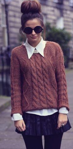 shades, a sweater and a bun