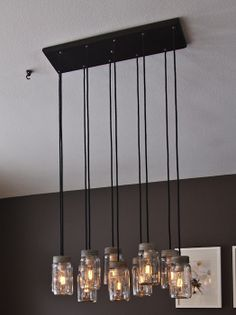DIY Jar Chandelier  Seen something like this on a kitchen remodel show - surprised how expensive it was.