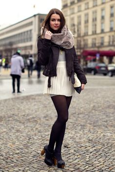 Love the pleated white mini paired with back staples. Plus the fur collar is the perfect accessory to this funky ensemble.