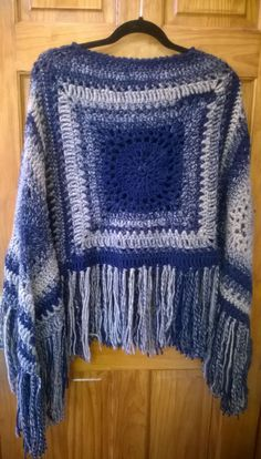 Easy crochet poncho, created by making 4 large crochet granny squares with some…