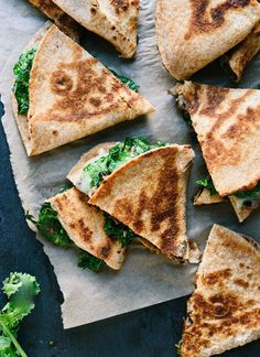 These bold quesadillas stuffed with #BroccoliRabe and black beans are perfect for Cinco de Mayo and busy weeknights. cookieandkate.com