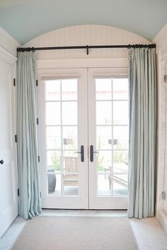 rounded ceiling with curtains by doors.. great for privacy!