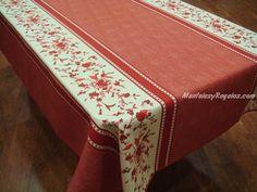 Mantel Antimanchas de Poliéster modelo FLORES ROJAS color rojo. Acabado con biés.