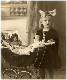 ~~Little girl with dolls in pram~~