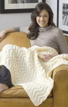 knit blanket. Not sure if this is reversible but it has a lot of knits and purls so it may be reversible. Good example of solid color afghan with a texture.