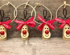This listing is for a Set of 4 Wine Cork Rudolph Ornaments tied with a white Rudolph ribbon. They will come packaged as a gift set like shown.  Here are just a few ideas of what these ornaments can be used for:  -Wine Lovers Gift Set -Wine Bottle Charms - Add one to every wine bottle you give as a gift! -Christmas Party Favors -Cookie Swap Favors/Decor -Christmas Tree Ornaments -Gift Wrap Embellishment  This is cork recycling at its best! These adorable Reindeer and Snowmen are handmade…