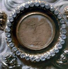 Close up of the Eucharistic Miracle of Douai-1254: While a priest distributing Communion, he unintentionally dropped a consecrated Host. He stooped to pick it up but it rose by itself and the host placed itself on the altar. Shortly after a beautiful child appeared, all the faithful of the church were present during this miraculous intercession. The relic is housed in the Church of Saint Peter at Douai, France