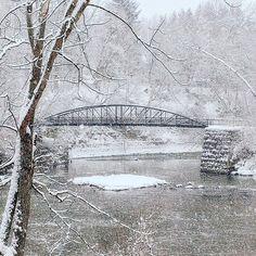 Bridge Over Winter Waters. #kkgroupies #pin #cvnp #roamohio #ohioexplored #cuyahogavalleynationalpark #simplepleasures #simplejoys #winterinohio #snow #ohio #myoh #ohphotography #winter #snowglobe #summitcounty #ohio #ohiophotography