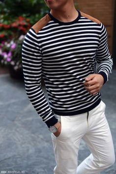 Want to wear stripes? Start with a navy and white horizontal stripe sweater and wear with chinos. Check out our collection of horizontal stripe outfits for men.