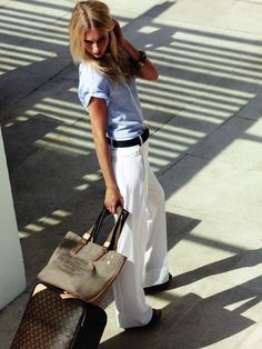 Long white trousers with wide black belt and tucked in light denim button up