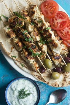 A delicious recipe for homemade chicken souvlaki made with an easy marinade and all the pita fixings. This Greek street food is packed with amazing flavors and is served with creamy tzatziki sauce. Quick Weeknight Dinners, Easy Meals, Souvlaki Recipe, Greek Chicken Souvlaki, Good Food, Yummy Food, Tasty, Moussaka, Greek Recipes