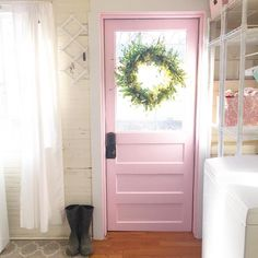 [The pink door makes the whole room feel different.  I love it.  I also like the way it looks with the cream walls.]  Pink laundry room door