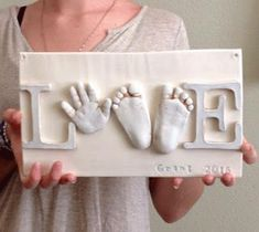 Adorable keepsake with baby hand and feet