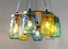 Sea Glass Mason Jar Chandelier, Upcycled Hanging Mason Jar Pendant Lighting Fixture, Rustic BootsNGus Lights and Home Decor, Bulbs Included by BootsNGus on Etsy https://www.etsy.com/listing/106130240/sea-glass-mason-jar-chandelier-upcycled