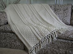 Hey, I found this really awesome Etsy listing at https://www.etsy.com/listing/468233409/ecru-crocheted-aran-afghan