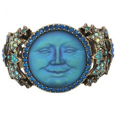 """When you wish upon a star…the Seaview Moon will magically appear! Celestial magic comes to you in the form of this stunning """"Stars in His Eyes Seaview Moon Cuff Bracelet"""".    This mesmerizing cuff is super comfortable and a breeze to put on and take off. Front and center of the cuff is the legendary Seaview Moon who has kind eyes and a warm simile that will delight your soul. This lunar lady reminds us that we are never alone and that are loved ones all gaze under the same moon each night."""