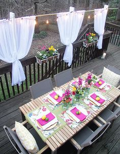 We love this patio idea! DIY privacy curtains that set up and fold away in minutes. You see them on a beautifully decorated backyard deck styled by Mallory Fitzsimmons of Charming in Charlotte. See all her patio decorating ideas on The Home Depot Blog. || @mallory_fitz