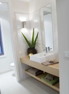toilet divider wall, sink area, white small tiles, light wood by StarMeKitten