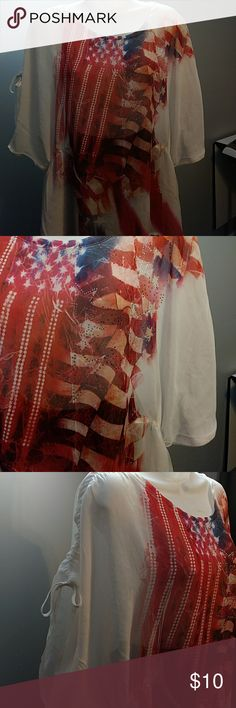 Closet Full American Flag blouse White blouse with Patriotic theme. American Flag with stars raised up. Cinched at waist and shoulders. The back is solid white. The front is a little shorter then back. closet full Tops Blouses