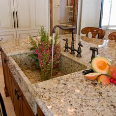 integrated kitchen sink- farmhouse kitchen sink made with matching natural stone as kitchen countertops.